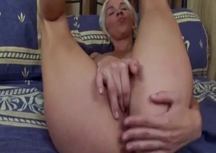 Big boobed blonde is sucking her fingers